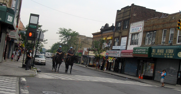 Pair of mounted police officers patrol Castleton Avenue in Staten Island - Photo: Cristina DC Pastor