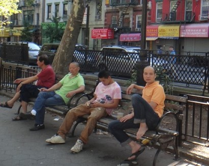 Men smoking in a Chinatown park.