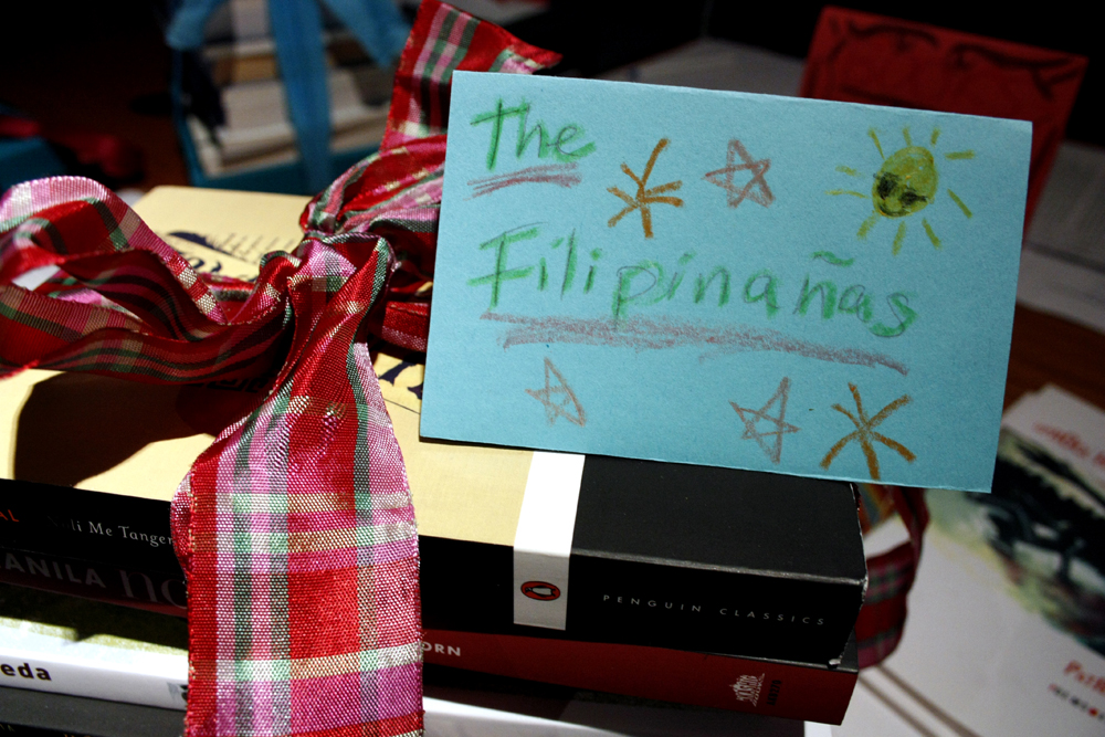 Books for auction at the 'Kaya Natin!' fundraiser at AAWW (Photo: Von Diaz)