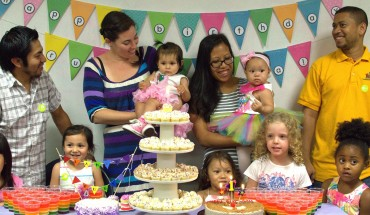 Grace Andrews and Sara Markel-Gonzalez, with their family at daughters' joint birthday party. Photo by Lily Chin, lilychin.info