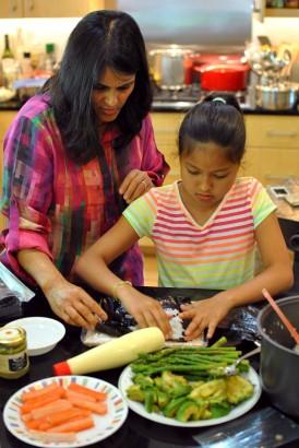 Sood Horiuchi teaches daughter to make California rolls