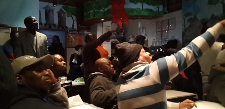 Soccer fans at La Savane, an Ivorian-Guinean restaurant in Harlem. (Photo: Pablo Medina Uribe)